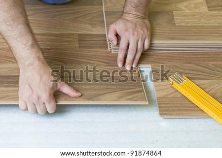 Installing wooden laminate flooring - stock photo