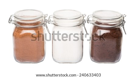 Instant coffee, chocolate drink powder and sugar in glass jar container - stock photo