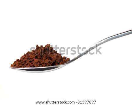 Instant coffee in the spoon - stock photo