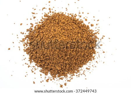 Instant granulated aromatic coffee on white background. - stock photo