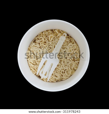 Instant noodle isolated on black - stock photo