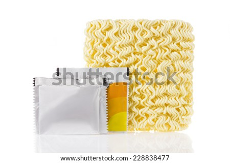 Instant noodle with spicy seasoning powder packages isolated on white background. - stock photo