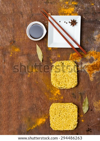 Instant noodles for cooking and eat in the dish on wooden background.  - stock photo