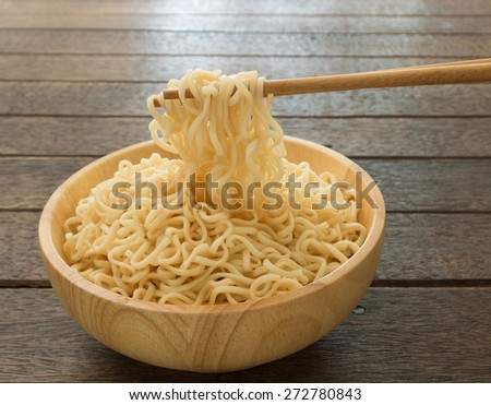 Instant noodles to clamp with chopsticks. - stock photo