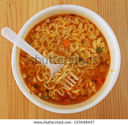Instant Noodles with a Plastic Fork - stock photo