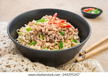 Instant noodles with pork in bowl  - stock photo