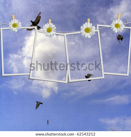 instant photo hanging on a rope with clothespins against blue sky - stock photo