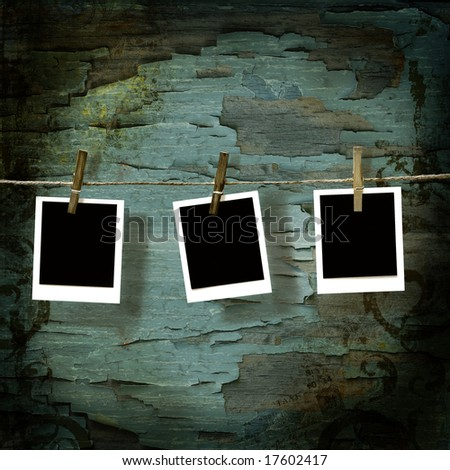 instant photo pictures  against old crackled backdrop - stock photo
