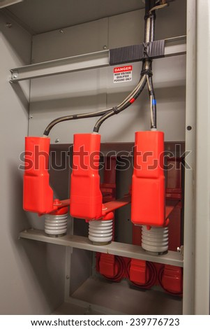 Insulated High voltage buswork and Cable Termination.  Actual classification is medium voltage for this 4160 volt system.  This is in the rear compartment of switchgear. - stock photo