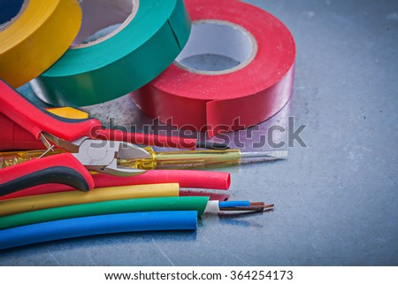 Insulating tapes electric cables insulated turnscrew cutting pliers construction concept. - stock photo