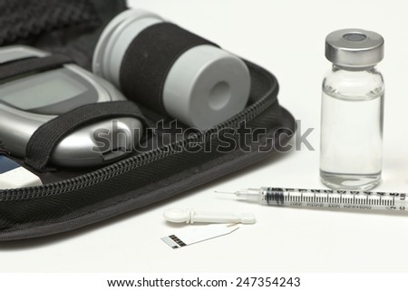 Insulin vial, syringe, lancet, strip and diabetic travel kit case. - stock photo
