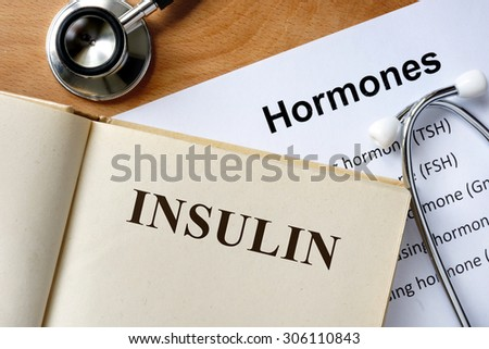 Insulin  word written on the book and hormones list. - stock photo