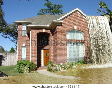 Insurance Agent's Nightmare, House with Waterfall flowing over the roof - stock photo