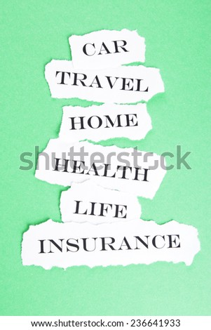 Insurance concept.Torn paper with different types of insurance - stock photo