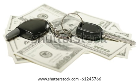 insurance concept, us dollars and car keys isolated on white background, selective focus - stock photo