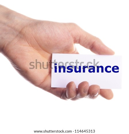 insurance concept with hand word an paper - stock photo