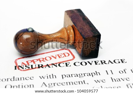 Insurance coverage and wooden stamp - stock photo