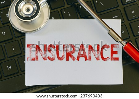 Insurance sign and stethoscope. Insurance sign and stethoscope. Medicine concept on computer keyboards - stock photo