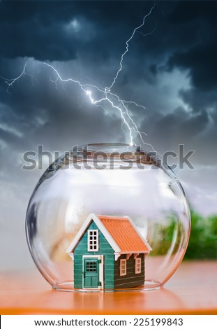 Insured house under protection, during natural calamities - stock photo