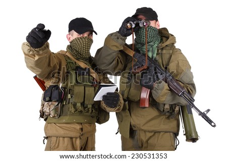 insurgents with AK 47 isolated on white background - stock photo