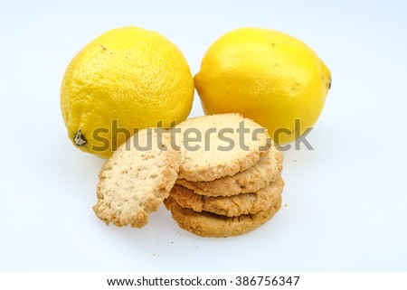 Integral biscuits and decorated lemon on white background - stock photo