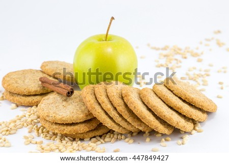 Integral biscuits with apple and wheat seeds on white background - stock photo