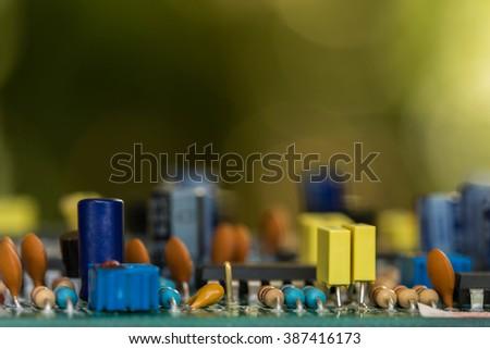 integrated circuit,resistors,capacitor,Shot of integrated circuit board. - stock photo