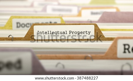 Intellectual Property on Business Folder in Multicolor Card Index. Closeup View. Blurred Image. 3D Render. - stock photo