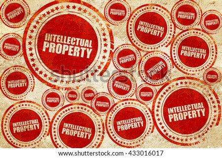 intellectual property, red stamp on a grunge paper texture - stock photo