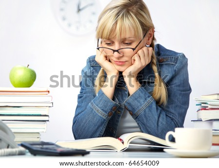 Intelligence girl student reads books in the library - stock photo