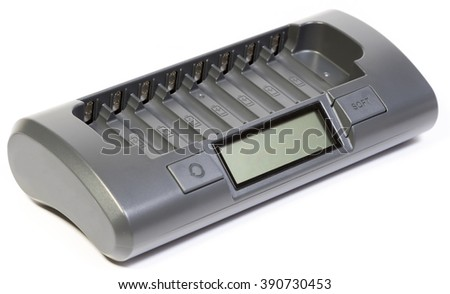 Intelligent battery charger, isolated on white backgroungd.Intelligent battery charger for 8 accumulators AA or AAA. - stock photo