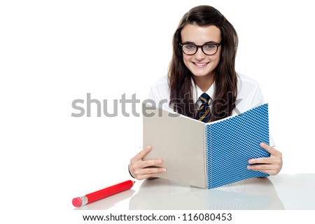 Intelligent student preparing for test, read notes - stock photo