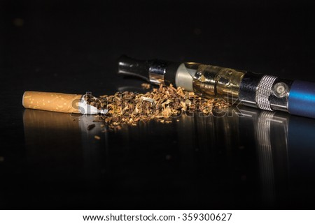 Intenational day : do not smoke today, May 31 - 2016.  End of flavored plug wrap cigarette stop smoking with an e-cigarette, on black background, reflected - stock photo