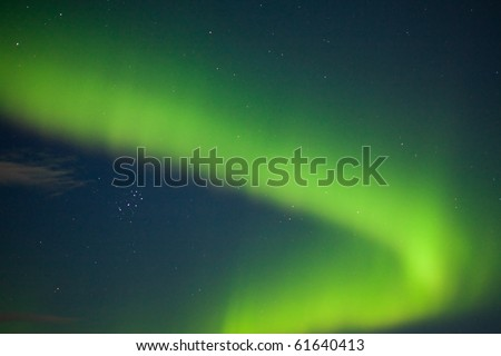 Intense Aurora borealis (northern lights) and lots of stars in moon lit night sky. - stock photo