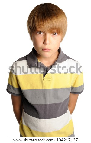 Intense Stare from a Young Boy. Nine year old boy staring directly at the viewer with an intense look. Isolated on white. - stock photo