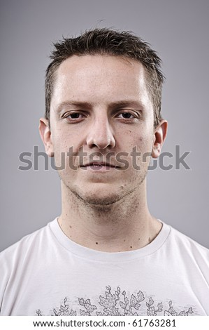 Intense young man poses for a portrait - stock photo