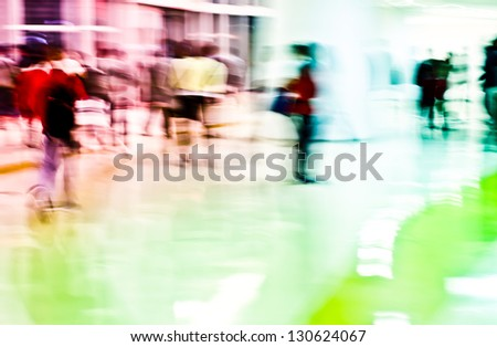 Intentional motion blur, urban business people walking in the lobby - stock photo