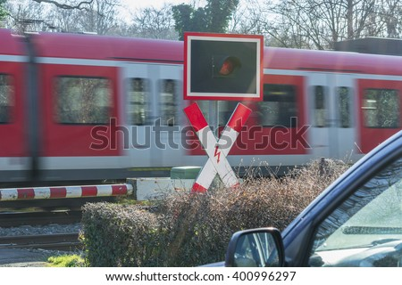 Intentional motion blur.Waiting at a railroad crossing while a fast passenger train drives past.  - stock photo