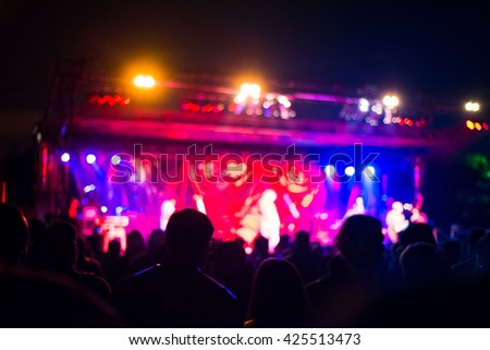 Intentionally blurred people viewing live concert - music, crowd, live concept - stock photo