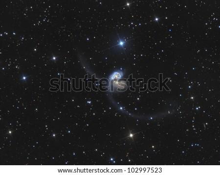 Interacting galaxies - stock photo