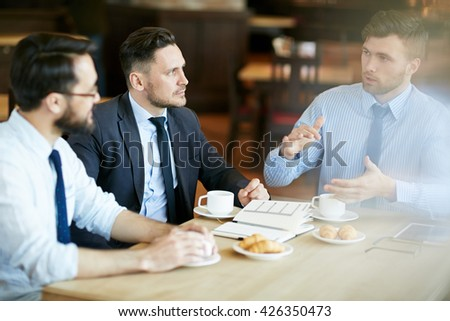 Interacting in cafe - stock photo