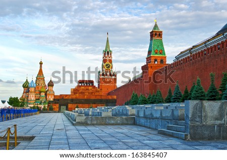 Intercession Cathedral (St. Basil's) and the Spassky Tower of Moscow Kremlin at Red Square in Moscow. Russia. - stock photo