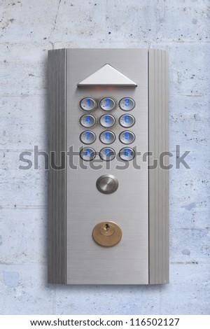 Intercom doorbell panel, isolated on stone - stock photo