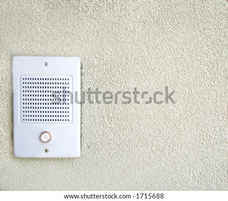 Intercom on stucco wall - stock photo