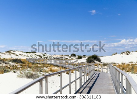 Interdune boardwalk inside the White Sands National Monument in New Mexico, USA - stock photo
