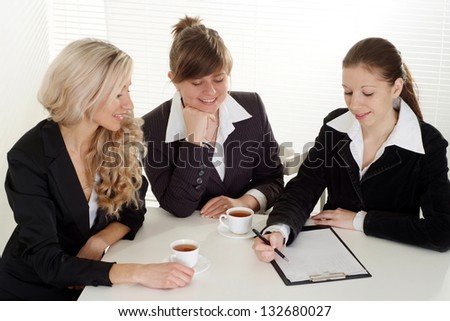 Interesring business people discuss important matters in their office - stock photo