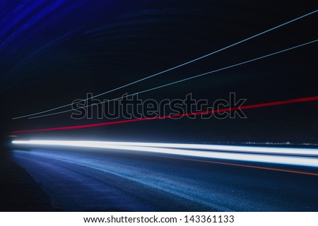 Interesting and abstract blue, white and red lights that can be used as background or texture - stock photo