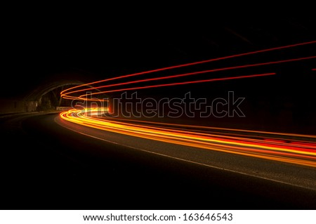 Interesting and abstract lights in orange that can be used as background or texture  - stock photo