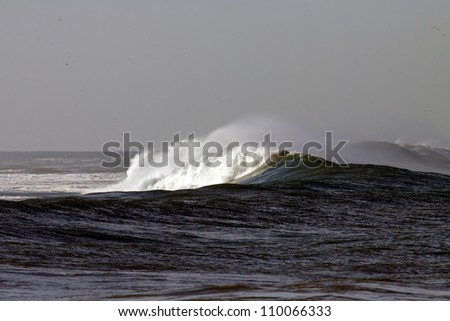 Interesting long big Atlantic white crashing wave in a stormy day - stock photo