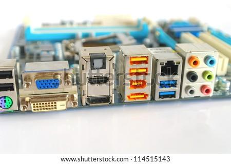 Interface plug-and-sockets of computer main board. Shallow DOF. - stock photo